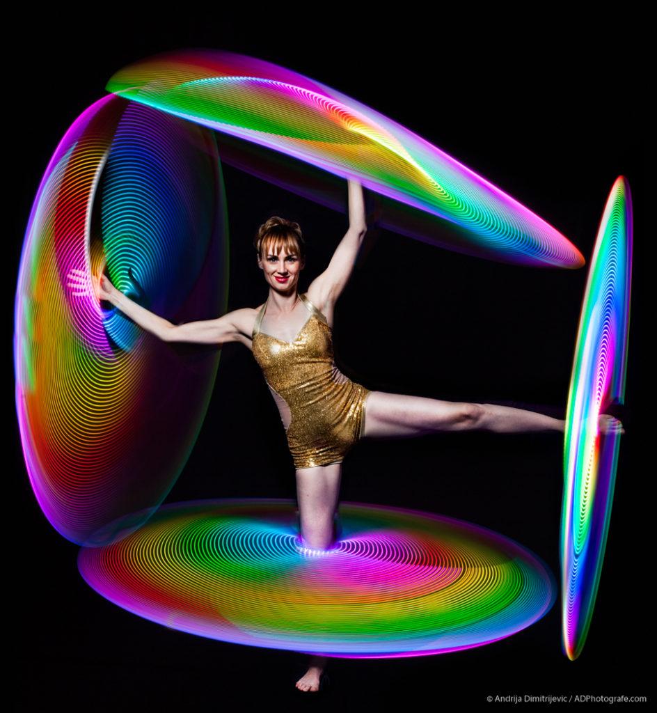 Kiki balancing four hula hoops