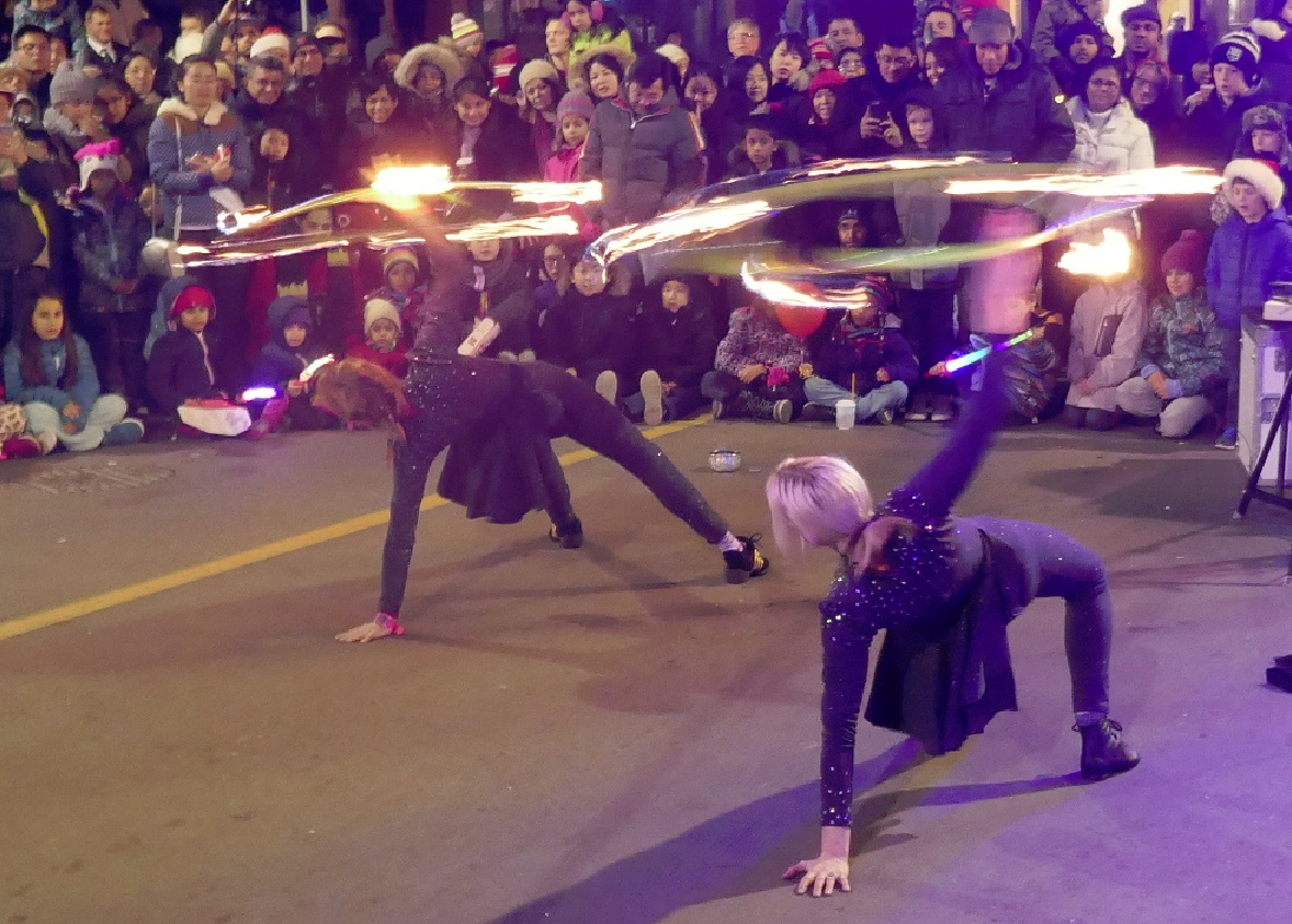 Isabella Hoops fire show on the street at outdoor festival
