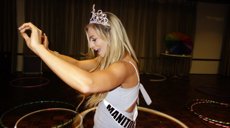 Miss World Canada hula hooping at opening party